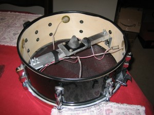 Here is the snare with the electric components all mounted inside of it. Note the snare wire serves absolutely no purpose here.